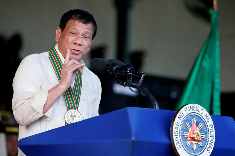 Philippine President Rodrigo Duterte gestures while addressing army troopers during the 120th anniversary celebration of the Philippine Army Tuesday, April 4, 2017 at Fort Bonifacio in suburban Taguig city, east of Manila, Philippines. AP/Bullit Marquez