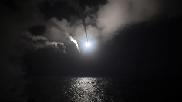 In this image provided by the U.S. Navy, the guided-missile destroyer USS Porter (DDG 78) launches a tomahawk land attack missile in the Mediterranean Sea, Friday, April 7, 2017. The United States blasted a Syrian air base with a barrage of cruise missiles in fiery retaliation for this week's gruesome chemical weapons attack against civilians. Ford Williams/U.S. Navy via AP
