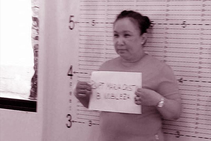 Photo shows police Superintendent Maria Cristina Nobleza undergoing booking at Camp Crame yesterday.