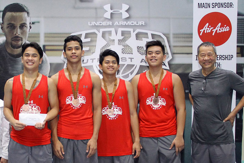Members of the University of Cebu Mariners pose with tournament commissioner Joe Lipa (right) after topping the Cebu leg of the Under Armour Under-18 3x3 basketball tournament.