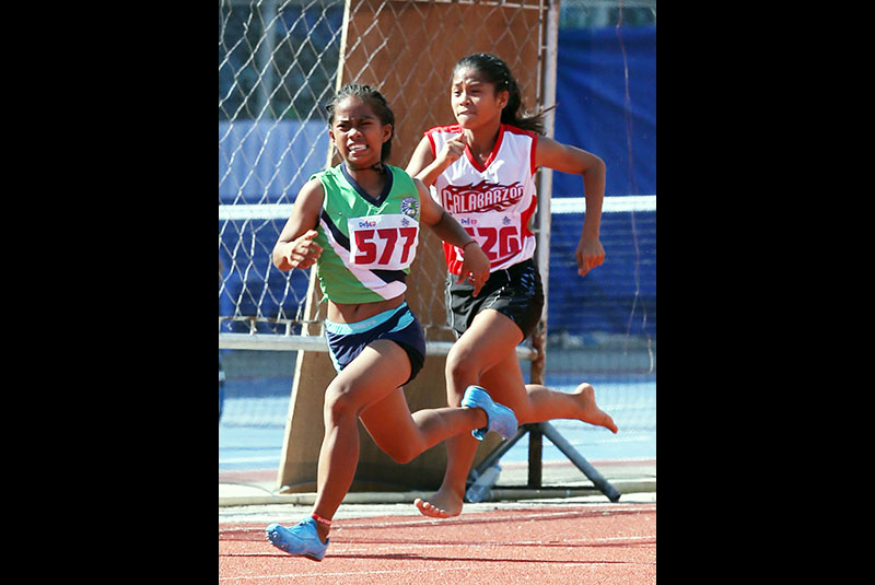 Reah Bacani of Iligan City summons her last ounce of strength to win the gold in 100m elementary girls final of the Palarong Pambansa at the Binirayan Sports Complex in Antique.