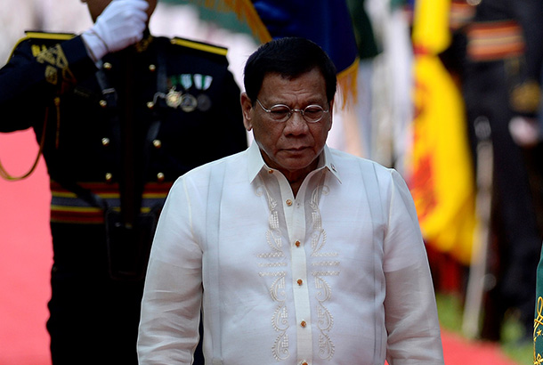 President Rodrigo Duterte during the welcoming ceremony for Brunei's Sultan Hassanal Bolkiah at the Malacañang Palace in Manila on April 27, 2017, ahead of the Association of Southeast Asian Nations (ASEAN) summit. The ASEAN summit in Manila, where leaders will discuss territorial disputes, terrorism and economic integration, takes place in the Philippine capital on April 28-29. Noel Celis/AFP