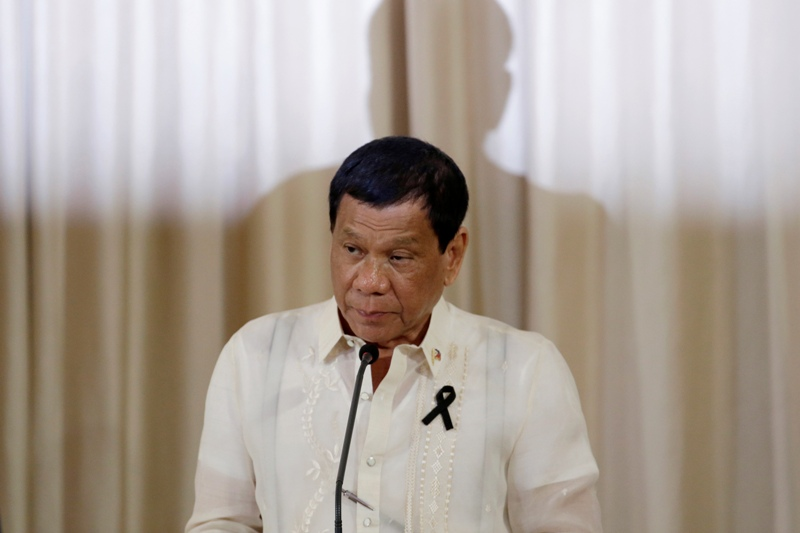FILE - In this Tuesday, March 21, 2017 Philippine President Rodrigo Duterte speaks during a joint press conference with Thailand's Prime Minister Prayuth Chan-ocha at the government house in Bangkok. Lawyer Jude Sabio from the Philippines has asked prosecutors of the International Criminal Court, ICC, to investigate his country's president for crimes against humanity for his alleged involvement in extrajudicial killings of suspected drug dealers and other crime suspects. AP/Sakchai Lalit