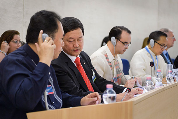 Head of the Philippines' delegation Menardo Guevarra (2nd L) listens to an assistant during the universal periodic review of the Philippines by the Office of the United Nations High Commissioner for Human Rights (OHCHR) on May 8, 2017 at the UN offices in Geneva. The Philippines' record is reviewed by the UN human rights council for the first time since the inauguration of President Rodrigo Duterte, who has been accused of massive violations in his so-called drug war. Fabrice Coffrini/AFP