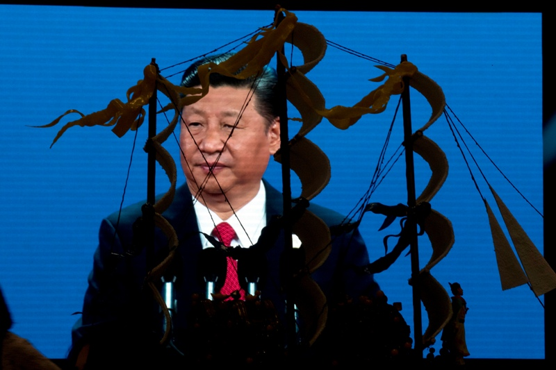 Chinese President Xi Jinping speaking at the opening of the Belt and Road Forum is displayed on a big screen near a decoration depicting Chinese Admiral Zheng He who commanded expeditionary voyages across Asia and East Africa in the 15th century in Beijing, China, Sunday, May 14, 2017. AP/Ng Han Guan