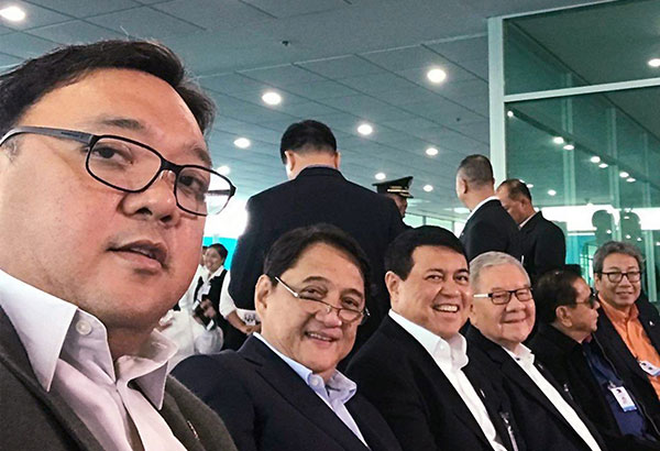 Davao Rep. Antonio Floirendo Jr., businessman Manny Villar, Quezon City Rep. Feliciano Belmonte Jr. and businessman Chavit Singson wait for the start of the President's speech at the Davao International Airport. REP. HARRY ROQUE TWITTER PHOTO