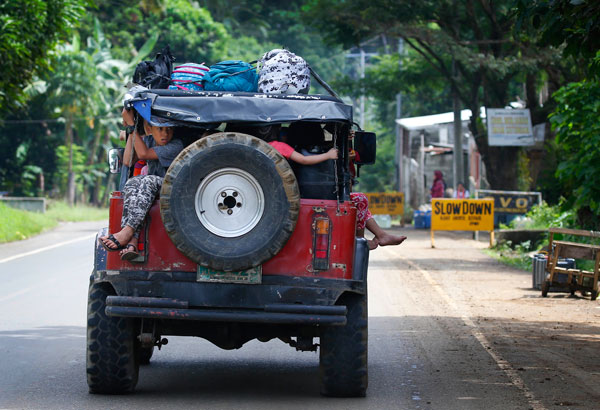 Residents fleeing the besieged city of Marawi travel to an evacuation center, Friday, May 26, 2017, in Bal-oi township, southern Philippines. Philippine army generals say dozens of Islamic State group-linked extremists have been killed in two days of fighting in a southern city that has been under siege since one of Asia's most-wanted militants evaded capture and dozens of rebels came to his aid. AP/Bullit Marquez