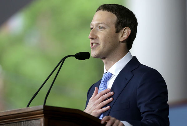 Facebook CEO and Harvard dropout Mark Zuckerberg delivers the commencement address at Harvard University commencement exercises, Thursday, May 25, 2017, in Cambridge, Mass., AP Photo/Steven Senne