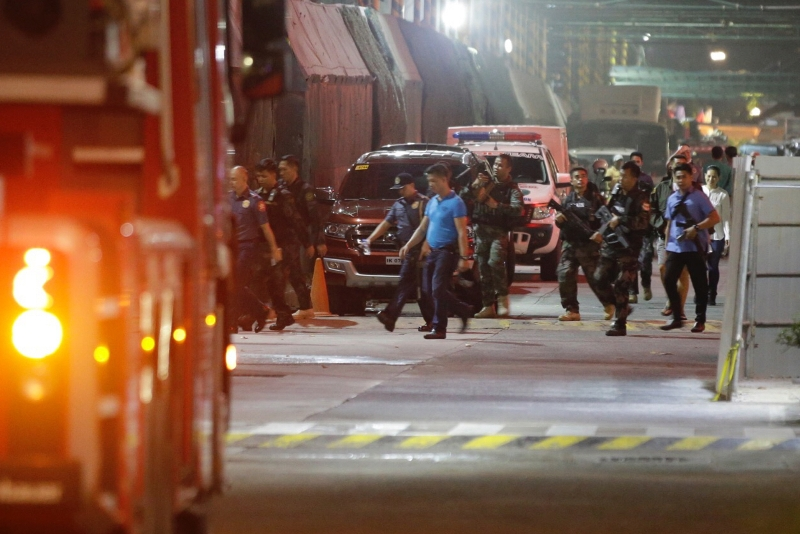 Armed security officers walk outside a hotel at the Resorts World Manila complex, early Friday, June 2, 2017, in Manila, Philippines. Gunshots and explosions rang out early Friday at a mall, casino and hotel complex near Manila's international airport in the Philippine capital, sparking a security alarm amid an ongoing Muslim militant siege in the country's south. AP/Aaron Favila
