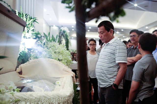 President Duterte visits the wake of the victims of casino attack in Pasay City. PPD / Released