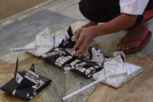 In this Friday, June 9, 2017, photo, a child plays with toy tanks made out of black and white election papers they found at a room in a temporary evacuation center at the provincial government capitol in Marawi city, southern Philippines. Nearly every day for the past three weeks, the Philippine military has pounded the lakeside town of Marawi with rockets and bombs as it tries to wipe out militants linked to the Islamic State group in some of the most protracted urban combat to hit this volatile region in decades. AP / Aaron Favila