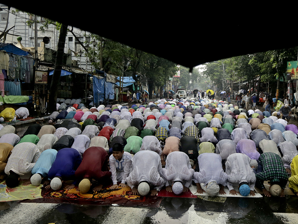 Indian Muslims pray on a street as it rains on the last Friday of the holy month of Ramadan in Kolkata, India, Friday, June 23, 2017. Muslims across the world are marking the holy month of Ramadan, a period of intense prayer, self-discipline, dawn-to-dusk fasting and nightly feasts. AP/Bikas Das