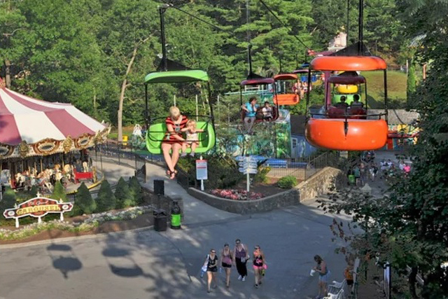 Crowd catches teen falling from park ride; no serious injury
