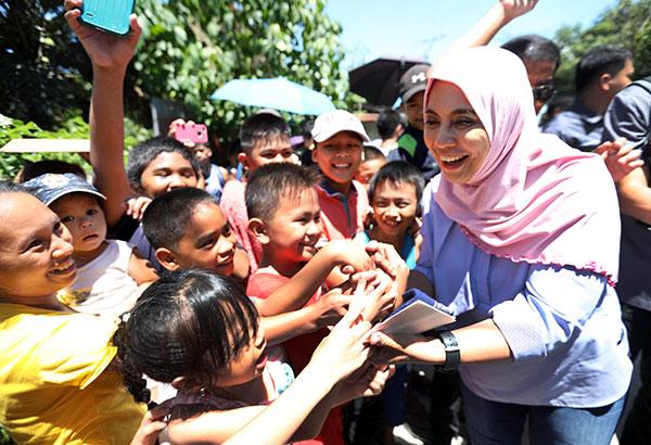 Vice President Leni Robredo greets children at an evacuation center in Iligan City yesterday. OVP PHOTO