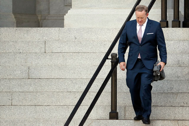 "Former White House press secretary Sean Spicer walks down the steps of the Eisenhower Executive Office Building towards the White House, Friday, July 21, 2017, in Washington. Spicer abruptly resigned his position, ending a rocky six-month tenure that made his news briefings defending President Donald Trump must-see TV. He said Trump's White House ""could benefit from a clean slate."" AP /Alex Brandon"