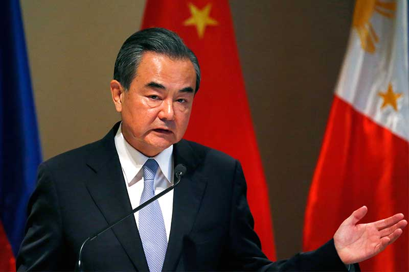 Chinese Foreign Minister Wang Yi gestures during a joint news conference with Philippine Foreign Affairs Secretary Alan Peter Cayetano following their bilateral meeting Tuesday, July 25, 2017 in suburban Taguig city, east of Manila, Philippines. The two officials discussed the South China Sea dispute and other issues concerning both countries. AP/Bullit Marquez