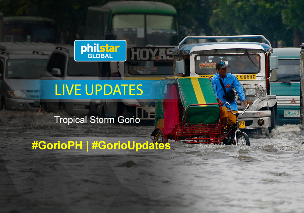 """Motorists maneuver through a flooded street after heavy rains brought about by tropical storm """"Nesat"""" flooded some parts of metropolitan Manila Thursday, July 27, 2017 in Manila, Philippines. The Philippine Atmospheric, Geophysical and Astronomical Services Administration (PAGASA) said the storm was packing maximum sustained winds of 85 kilometers per hour (53 miles per hour) in northeastern Philippines and is not expected to hit land but will enhance the southwest monsoon which will bring heavy rains over the western section of the main Luzon island. Classes have been suspended in different parts of Metro Manila and nearby provinces Thursday. AP/Bullit Marquez"""