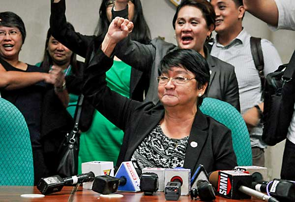 Social Welfare Secretary Judy Taguiwalo raises a clenched fist during a press conference after the rejection of her nomination by the Commission on Appointments at the Senate yesterday.  GEREMY PINTOLO