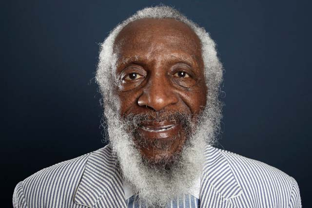 In this July 21, 2012 file photo, comedian and activist Dick Gregory poses for a portrait during the PBS TCA Press Tour in Beverly Hills, Calif. Gregory, the comedian and activist and who broke racial barriers in the 1960s and used his humor to spread messages of social justice and nutritional health, has died. He was 84. Gregory died late Saturday, Aug. 19, 2017, in Washington, D.C. after being hospitalized for about a week, his son Christian Gregory told The Associated Press. He had suffered a severe bacterial infection. Photo by Matt Sayles/Invision/AP, File