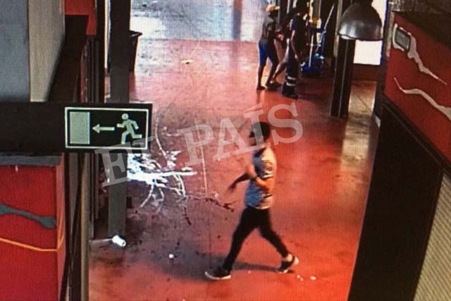 In this watermarked frame grab from CCTV released by the Spanish newspaper El Pais on Monday Aug. 21, 2017, a suspect. believed to be Younes Abouyaaqoub is is captured by a security camera walking through La Boqueria market seconds after a van crashed into pedestrians in Barcelona last August 17. Spanish newspaper El Pais published images Monday of what it says is Younes Abouyaaqoub supposedly making a getaway on foot after the Barcelona van attack. The three images show a slim man wearing sunglasses seemingly walking through what El Pais says is traditional La Boqueria market just off Las Ramblas. EL Pais, via AP