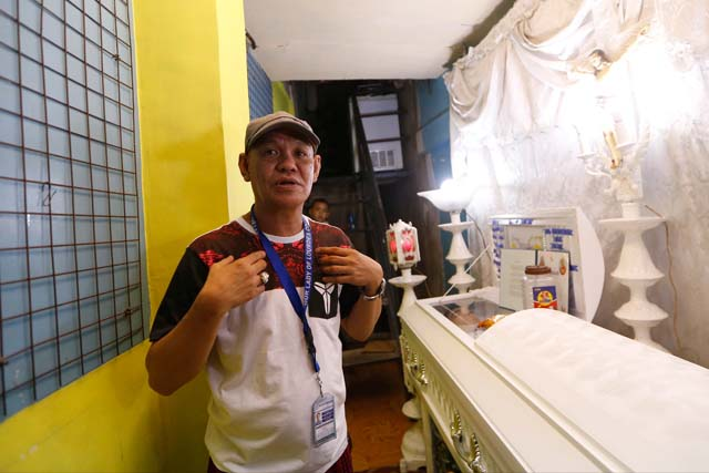 Saldy Delos Santos, father of Kian Loyd, a 17-year-old Grade 11 student, who was killed allegedly in a shootout with police, describes his son's killing at his wake in their house Friday, Aug. 18, 2017 in Caloocan city north of Manila, Philippines. The killing of Kian has sparked protests and condemnation from concerned citizens.AP / Bullit Marquez