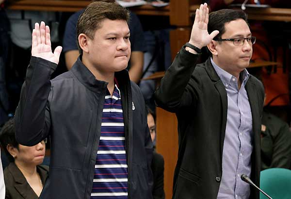 SHOW MY TATTOO? NO WAY! Presidential son Paolo Duterte and son-in-law Manases Carpio take their oath during the Senate probe yesterday on the P6.4-billion shabu from China. GEREMY PINTOLO