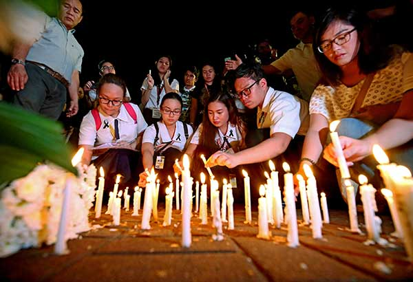 University of Santo Tomas students light candles for law student Horacio Castillo III during a ceremony at the campus plaza this week. MIGUEL DE GUZMAN, file