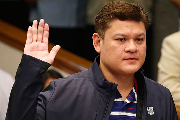 """Paolo Duterte, the eldest son of President Rodrigo Duterte takes his oath in the continuing senate probe on the more than half a ton of the illegal drug methamphetamine hydrochloride, locally known as """"Shabu"""" worth $128 million (P6.4 Billion Pesos) from China which passed through customs from China Thursday, Sept. 7, 2017, in Pasay city, southeast of Manila, Philippines. AP Photo/Bullit Marquez"""