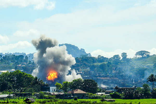Smoke billows from houses after aerial bombings by Philippine Airforce planes on Islamist militant positions in Marawi on the southern island of Mindanao on September 17, 2017. The Philippine military said on September 17 it had captured the command centre of Islamic State group supporters who have besieged a southern city for nearly four months. Ferdinandh Cabrera/AFP