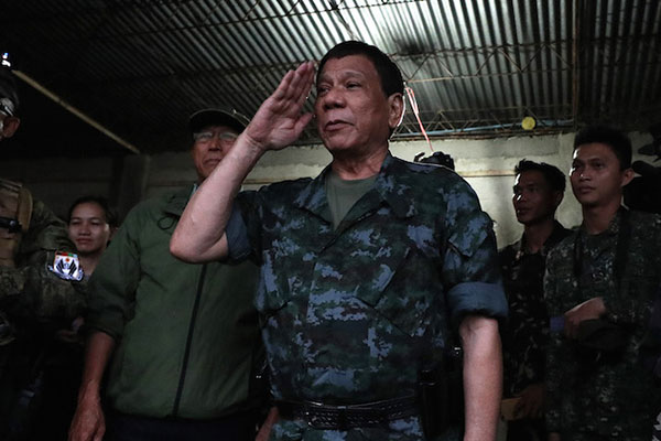 In joint session last Wednesday, legislators voted 240-27 to allow President Rodrigo Duterte to extend martial law in Mindanao by a year after it lapses on Dec. 31. Robinson Niñal Jr./Presidential Photo, File