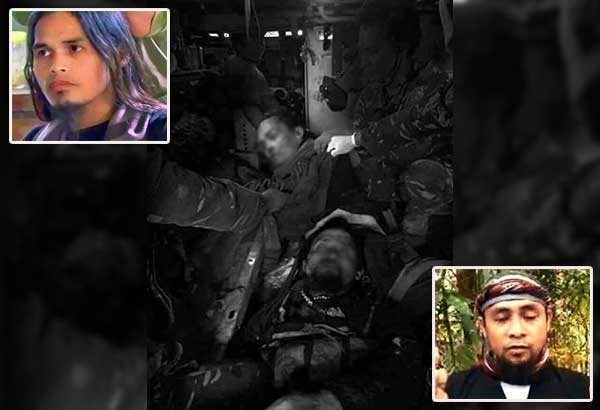 The bodies of Omarkhayam Maute (top, below inset) and Isnilon Hapilon are seen inside a military helicopter after they were killed by troops in the main battle area of Marawi City yesterday. Hapilon was the leader of the Abu Sayyaf and the Islamic State's anointed 'emir' in Southeast Asia while Omar Maute was one of two brothers who founded the Maute terrorist group in Mindanao.