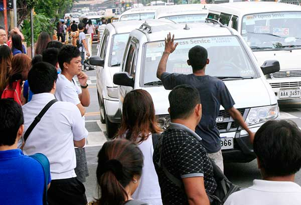 Commuters wait for a ride along España in Manila during the jeepney strike yesterday. EDD GUMBAN