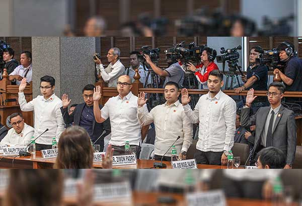 Aegis Juris members (from left) Ralph Trangia, Arvin Balag, Aeron Salientes, Zimon Padro, Jose Miguel Salamat and Ranie Rafael Santiago take their oath at the Senate hearing on the fatal hazing of Horacio Castillo III yesterday. Balag was later detained at the Senate for contempt. Geremy Pintolo
