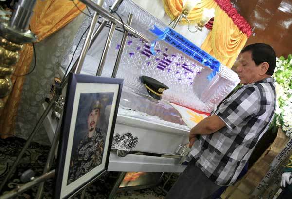 President Rodrigo Duterte on Friday, October 13, attended the wake of a young army officer who died in Marawi City. PCOO