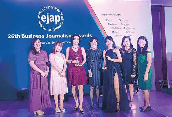 EJAP AWARDEES: STAR business reporters Iris Gonzales (3rd from left) and Prinz Magtulis (not in photo) won as Best Reporter in Capital Markets and Best Reporter in Finance, respectively, at the 26th Economic Journalists Association of the Philippines' Business Journalism Awards held at the Manila Polo Club last Friday. Also in photo are business editor Marianne Go (4th from left) and reporters Danessa Rivera, Mary Grace Padin, Louella Desiderio, Louise Maureen Simeon and Catherine Talavera.
