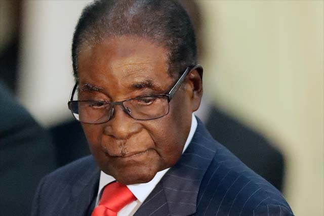 "In this file photo dated Tuesday, Oct. 3, 2017, Zimbabwean President Robert Mugabe during his meeting with South African President Jacob Zuma, at the Presidential Guesthouse in Pretoria, South Africa. In a statement Sunday Oct. 22, 2017 World Health Organization director-general Tedros Ghebreyesus announced he has decided to revoke his appointment of Zimbabwe's President Robert Mugabe as a ""goodwill ambassador"" after the choice drew widespread international criticism. AP /Themba Hadebe, FILE"