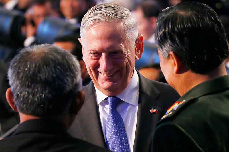U.S. Defense Secretary Jim Mattis is greeted by unidentified delegates as he arrives to take part in the two-day ASEAN Defense Ministers' Meeting and its Dialogue Partners Tuesday, Oct. 24, 2017 at Clark, Pampanga province, north of Manila, Philippines. AP/Bullit Marquez
