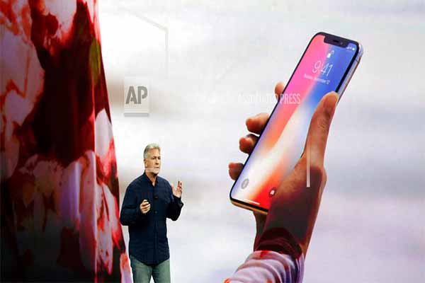 In this Tuesday, Sept. 12, 2017, file photo, Phil Schiller, Apple's senior vice president of worldwide marketing, announces features of the new iPhone X, including Face ID, at the Steve Jobs Theater on the new Apple campus, in Cupertino, Calif. Apple's new Face ID facial recognition system is due to debut with the iPhone X on Nov. 3. The system lets users unlock their phones just by glancing at them, but have also raised privacy questions and some anxieties over the ease with which others unlock a user's phone. AP Photo/Marcio Jose Sanchez, File