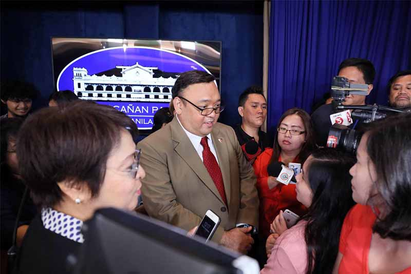 Presidential spokesperson Harry Roque has refused to comment on the critical statement of his former law firm criticizing the decision of the Securities and Exchange Commission to cancel the corporate registration of news websit Rappler. Presidential Photo/Ace Morandante, File