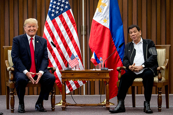 Philippines President Rodrigo Duterte, accompanied by U.S. President Donald Trump, left, speaks during a bilateral meeting at the ASEAN Summit at the Philippine International Convention Center, Monday, Nov. 13, 2017, in Manila, Philippines. AP Photo/Andrew Harnik