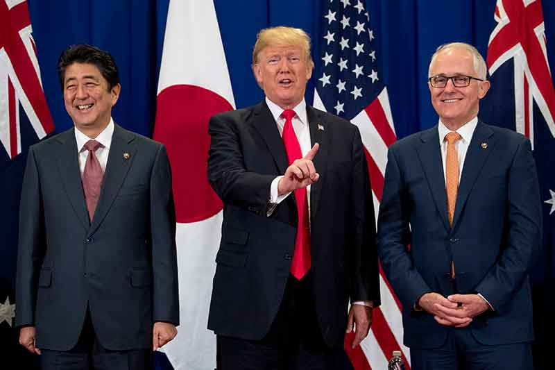 President Donald Trump, accompanied by Japanese Prime Minister Shinzo Abe, left, and Australian Prime Minister Malcolm Turnbull, right, speaks to reporters at a meeting during the ASEAN Summit at the Sofitel Philippine Plaza, Monday, Nov. 13, 2017, in Manila, Philippines. Trump is on a five country trip through Asia traveling to Japan, South Korea, China, Vietnam and the Philippines. AP/Andrew Harnik