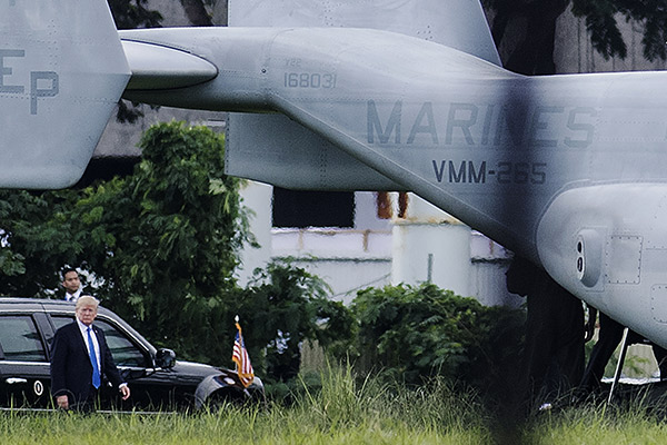 US President Donald Trump prepares to board Marine One (not pictured) after attending the 31st Association of Southeast Asian Nations (ASEAN) Summit and Related Meetings in Manila on November 14, 2017. The US president was in the Philippines with leaders of 18 other nations for two days of summits, the final leg of a headline-grabbing Asian tour dominated by the North Korean nuclear crisis. Noel Celis/AFP