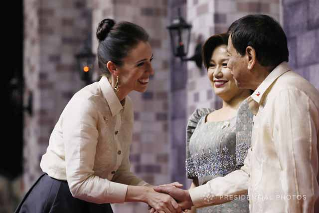 In this Nov. 12, 2017 file photo, New Zealand Prime Minister Jacinda Arden attends the ASEAN gala dinner celebration. She was greeted by President Rodrigo Duterte. PPD/Ace Morandante