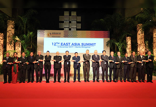 ASEAN leaders led by President Duterte and dialogue partners link arms at the start of the 12th East Asia Summit at the PICC yesterday. State Secretary Rex Tillerson (fifth from left) attended for US President Donald Trump who left the country ahead of the summit. Edd Gumban