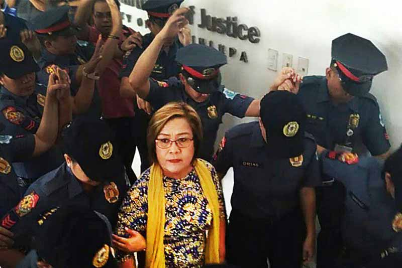 Sen. Leila M. de Lima was escorted by members of the Philippine National Police (PNP) as she arrived today, Nov. 16, at the Muntinlupa RTC Branch 204 to answer the trumped-up illegal drug trading charge filed against her. Leila de Lima/Released