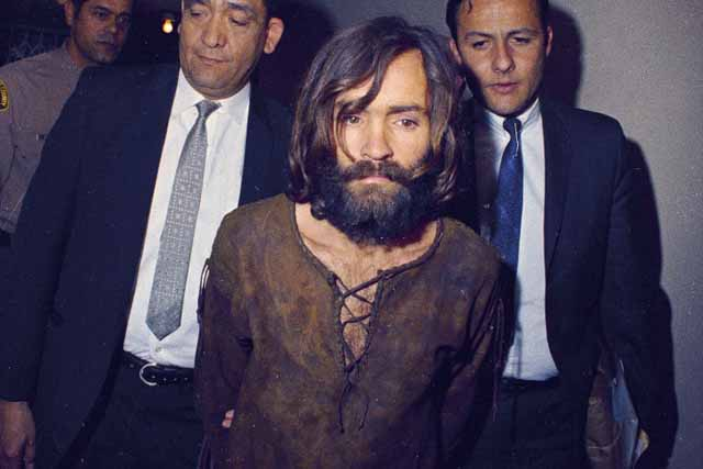 Charles Manson is escorted to his arraignment on conspiracy-murder charges in conneciton with the Sharon Tate murder case, 1969, Los Angeles. AP/File photo
