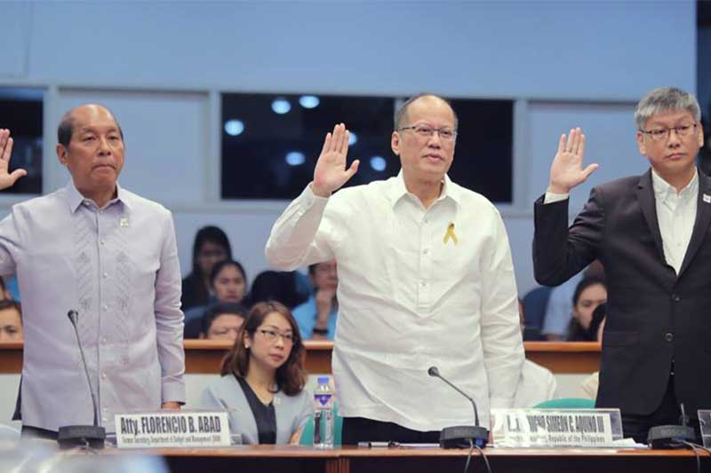 Former President Noynoy Aquino, together with former Executive Secretary Paquito Ochoa and former Budget Secretary Butch Abad took their oath during the hearing on the alleged P3.5 Billion worth of questionable dengue vaccines that had been administered by the DOH to 280,000 students without passing through WHO prequalification requirements. Senate PRIB/Joseph Vidal