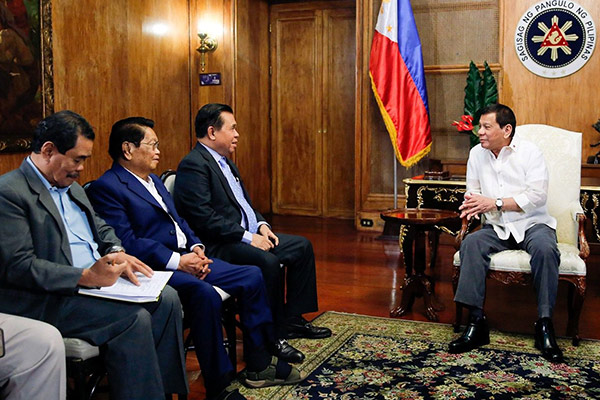In this Sept. 4, 2017 photo, President Rodrigo Duterte meets with Moro Islamic Liberation Chair Al Haj Murad Ebrahim during a meeting in Malacañan Palace. Also joining Murad are Bangsamoro Transition Commission Chair Ghazali Jaafar, and Moro Islamic Liberation Front peace implementing panel Chair Mohagher Iqbal. Rolando Mailo/Presidential Photo