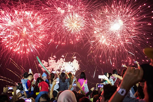 People watch fireworks display during New Year Celebration in Manila on January 1, 2018. The Philippines is mainly Roman Catholic but the celebrations draw on ancient superstitions and Chinese traditions in which the noise from firecrackers is meant to drive away evil spirits and bring good luck in the coming year. Adding to the danger of annual fireworks celebrations in the streets, there are over 1.2 million unlicensed firearms in the Philippines and some of those are used in the festivities.Noel Celis/AFP