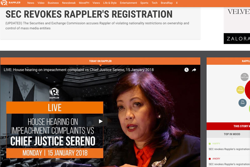 """In what Rappler said was a major blow to press freedom, the SEC cancelled the multimedia news organization's license, accusing it of effecting a """"deceptive scheme to circumvent the Constitution"""" especially through its getting funds from Omidyar Network of eBay founder Pierre Omidyar. File"""